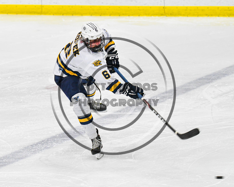 West Genesee Wildcats Jake Kopek (6) fires the puck at the Fayetteville-Manlius Hornets net in a NYSPHSAA Section III Boys Ice hockey playoff game at the Shove Park in Camillus, New York on Wednesday, February 26, 2020. West Genesee won 4-1.