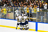 West Genesee Wildcats players and students celebrate a goal by Wildcats Jeremy Keyes (19) against the Fayetteville-Manlius Hornets in a NYSPHSAA Section III Boys Ice hockey playoff game at the Shove Park in Camillus, New York on Wednesday, February 26, 2020. West Genesee won 4-1.