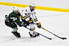 West Genesee Wildcats Jeremy Keyes (19) with the puck against Fayetteville-Manlius Hornets Will Duncanson (2) in a NYSPHSAA Section III Boys Ice hockey playoff game at the Shove Park in Camillus, New York on Wednesday, February 26, 2020. West Genesee won 4-1.