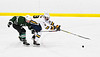 West Genesee Wildcats Jeremy Keyes (19) gets hooked by Fayetteville-Manlius Hornets Jason Tedeschi (23) in a NYSPHSAA Section III Boys Ice hockey playoff game at the Shove Park in Camillus, New York on Wednesday, February 26, 2020. West Genesee won 4-1.
