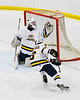 West Genesee Wildcats goalie David Myers (1) tracks the puck as it goes over the net against the Fayetteville-Manlius Hornets in a NYSPHSAA Section III Boys Ice hockey playoff game at the Shove Park in Camillus, New York on Wednesday, February 26, 2020. West Genesee won 4-1.