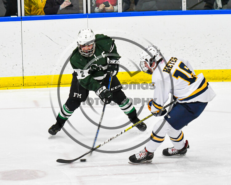 West Genesee Wildcats Jeremy Keyes (19) defending against Fayetteville-Manlius Hornets Will Duncanson (2) in a NYSPHSAA Section III Boys Ice hockey playoff game at the Shove Park in Camillus, New York on Wednesday, February 26, 2020. West Genesee won 4-1.