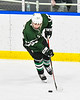 Fayetteville-Manlius Hornets John Manzi (27) with the puck against the West Genesee Wildcats in a NYSPHSAA Section III Boys Ice hockey playoff game at the Shove Park in Camillus, New York on Wednesday, February 26, 2020. West Genesee won 4-1.
