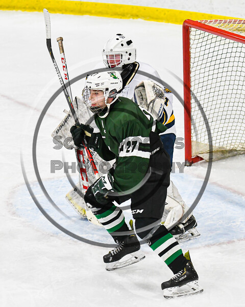 Fayetteville-Manlius Hornets John Manzi (27) sets up in front of West Genesee Wildcats goalie David Myers (1) in a NYSPHSAA Section III Boys Ice hockey playoff game at the Shove Park in Camillus, New York on Wednesday, February 26, 2020. West Genesee won 4-1.