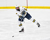 West Genesee Wildcats w06 Jake Kopek (6) passes the puck against Fayetteville-Manlius Hornets in a NYSPHSAA Section III Boys Ice hockey playoff game at the Shove Park in Camillus, New York on Wednesday, February 26, 2020. West Genesee won 4-1.