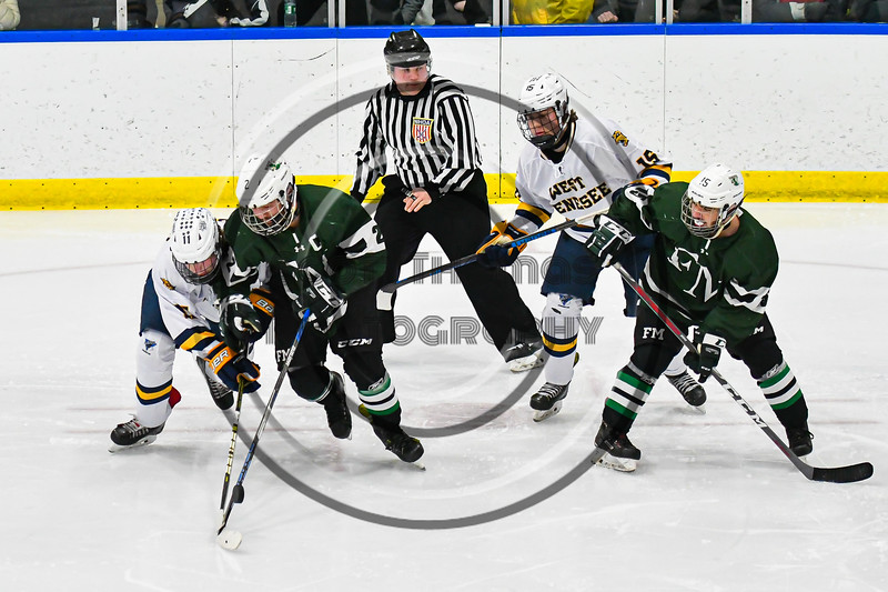 West Genesee Wildcats Andrew Schneid (11) battles for the puck with Fayetteville-Manlius Hornets Will Duncanson (2) in a NYSPHSAA Section III Boys Ice hockey playoff game at the Shove Park in Camillus, New York on Wednesday, February 26, 2020. West Genesee won 4-1.