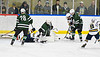 West Genesee Wildcats and Fayetteville-Manlius Hornets players battles for the puck in a NYSPHSAA Section III Boys Ice hockey playoff game at the Shove Park in Camillus, New York on Wednesday, February 26, 2020. West Genesee won 4-1.