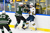 Fayetteville-Manlius Hornets Spencer Sasenbury (28) checks West Genesee Wildcats James Schneid (15) in a NYSPHSAA Section III Boys Ice hockey playoff game at the Shove Park in Camillus, New York on Wednesday, February 26, 2020. West Genesee won 4-1.