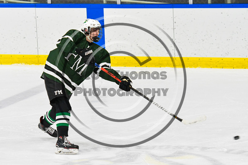 Fayetteville-Manlius Hornets Spencer Sasenbury (28) fires the puck at the West Genesee Wildcats net in a NYSPHSAA Section III Boys Ice hockey playoff game at the Shove Park in Camillus, New York on Wednesday, February 26, 2020. West Genesee won 4-1.
