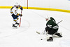 Fayetteville-Manlius Hornets goalie Konrad Walberger (1) makes a save against West Genesee Wildcats Max Hahn (28) in a NYSPHSAA Section III Boys Ice hockey playoff game at the Shove Park in Camillus, New York on Wednesday, February 26, 2020. West Genesee won 4-1.