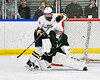 West Genesee Wildcats Billy Fisher (8) collides with  Fayetteville-Manlius Hornets goalie Konrad Walberger (1) in a NYSPHSAA Section III Boys Ice hockey playoff game at the Shove Park in Camillus, New York on Wednesday, February 26, 2020. West Genesee won 4-1.