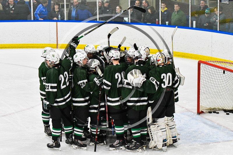 Fayetteville-Manlius Hornets huddle up before playing the West Genesee Wildcats in a NYSPHSAA Section III Boys Ice hockey playoff game at the Shove Park in Camillus, New York on Wednesday, February 26, 2020.