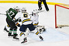 Fayetteville-Manlius Hornets John Manzi (27) deflects the puck past West Genesee Wildcats goalie David Myers (1) for a goal in a NYSPHSAA Section III Boys Ice hockey playoff game at the Shove Park in Camillus, New York on Wednesday, February 26, 2020. West Genesee won 4-1.