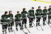 Fayetteville-Manlius Hornets players during the National Anthem before playing the West Genesee Wildcats in a NYSPHSAA Section III Boys Ice hockey playoff game at the Shove Park in Camillus, New York on Wednesday, February 26, 2020.