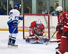 Baldwinsville goaltender Nick Leader (30) smothers the puck in the 3rd period to protect a one goal lead while CNS forward Brad Monroe (27) looks for a rebound in Boys Varsity Ice Hockey on Friday, January 23, 2009.  Baldwinsville held on to win 2-1.