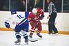 Baldwinsville's Brad Burlingame (17) comes down the ice against CNS defenseman Alex Zubrowski (10) in Boys Varsity Ice Hockey on Friday, January 23, 2009.  Baldwinsville won 2-1.