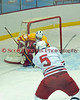 Baldwinsville's Connor Bertrand (5) fires a shot stopped by Ithaca goaltender Cooper Belyea (29) in first period play.