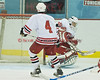 Baldwinsville goaltender Nick Leader (20) smothers a shot while Mark Belluci (4) looks to clear any rebound.