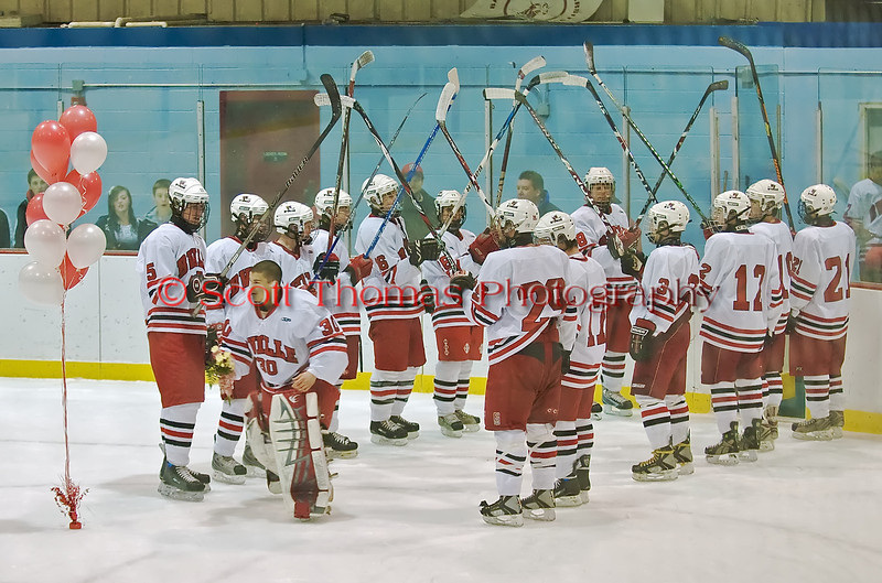 Underclassmen create an arch with their hockey sticks for Nick Leader (30)  on Senior Night on the last home game for the Baldwinsville Bees hockey game against Ithaca on Thursday, February 5, 2009.  B'ville won 4-2.