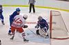Oswego's goaltender Matt Howard (1) makes one of his 40 saves against Baldwinsville's Brad Burlingame (17) in Boy's Ice Hockey on Thursday, January 29, 2009.  Oswego won 2-1.