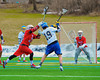Cazenovia Lakers Peter Burr (19) winds up for a shot while being defended by Baldwinsville Bees Jake Anderson (22) in Boys Lacrosse on Saturday, April 5, 2015 at Cazenovia, New York. Cazenovia won 13-5.
