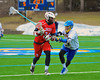 Baldwinsville Bees Charlie Bertrand (24) being defended by Cazenovia Lakers TJ Connelian (23) in Boys Lacrosse on Saturday, April 5, 2015 at Cazenovia, New York. Cazenovia won 13-5.