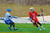 Baldwinsville Bees Connor Chapman (12) being defended by a Cazenovia Lakers player in Boys Lacrosse on Saturday, April 5, 2015 at Cazenovia, New York. Cazenovia won 13-5.