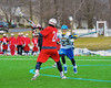 Baldwinsville Bees Charlie Bertrand (24) winds up for a shot against the Cazenovia Lakers in Boys Lacrosse on Saturday, April 5, 2015 at Cazenovia, New York. Cazenovia won 13-5.