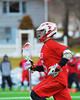 Baldwinsville Bees Kyle Akers (25) brings the ball up field against the Cazenovia Lakers in Boys Lacrosse on Saturday, April 5, 2015 at Cazenovia, New York. Cazenovia won 13-5.