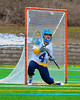 Cazenovia Lakers Trevor Cross (4) in net against the Baldwinsville Bees in Boys Lacrosse on Saturday, April 5, 2015 at Cazenovia, New York. Cazenovia won 13-5.