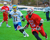 Baldwinsville Bees Kyle Akers (25) being chased by Cazenovia Lakers Eli Mitchell (11) in Boys Lacrosse on Saturday, April 5, 2015 at Cazenovia, New York. Cazenovia won 13-5.