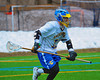 Cazenovia Lakers Eli Mitchell (11) bringing the ball up field against the Baldwinsville Bees in Boys Lacrosse on Saturday, April 5, 2015 at Cazenovia, New York. Cazenovia won 13-5.