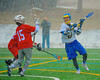 Cazenovia Lakers Henry Mann (2) lining up a shot at Baldwinsville Bees goalie Daniel Thomas (15) during a Spring snow shower on Saturday, April 5, 2015 at Cazenovia, New York. Cazenovia won 13-5.