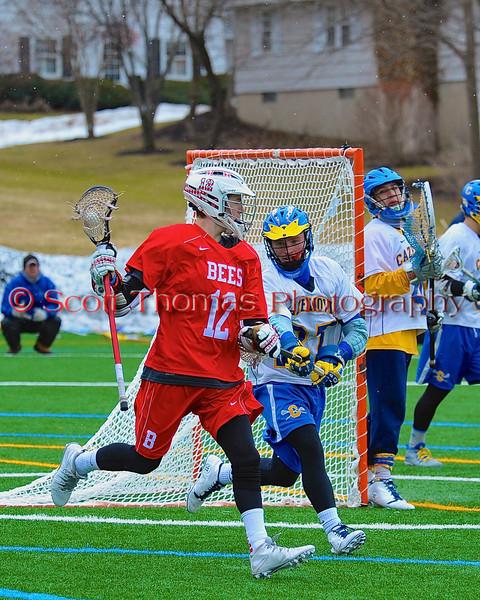 Baldwinsville Bees Connor Chapman (12) behind the Cazenovia Lakers net in Boys Lacrosse on Saturday, April 5, 2015 at Cazenovia, New York. Cazenovia won 13-5.