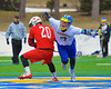 Cazenovia Lakers Henry Mann (2) wins a face-off against Baldwinsville Bees Luke McCaffrey (20) on Saturday, April 5, 2015 at Cazenovia, New York. Cazenovia won 13-5.