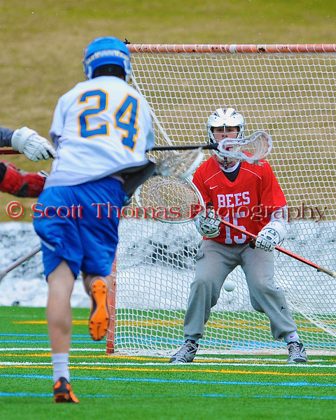 Cazenovia Lakers Cole Willard  (24) goes five hole on Baldwinsville Bees goalie Daniel Thomas (15) for a score on Saturday, April 5, 2015 at Cazenovia, New York. Cazenovia won 13-5.