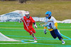 Baldwinsville Bees Sean Barron (11) chases after Cazenovia Lakers goalie Trevor Cross (4) in Boys Lacrosse on Saturday, April 5, 2015 at Cazenovia, New York. Cazenovia won 13-5.