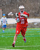 Baldwinsville Bees Eric Candee (10) looking to make a pass against the Cazenovia Lakers in Boys Lacrosse on Saturday, April 5, 2015 at Cazenovia, New York. Cazenovia won 13-5.