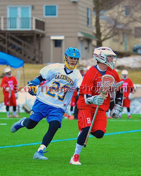 Baldwinsville Bees Mitch Rein (1) keeps Cazenovia Lakers TJ Connelian (23) at bay in Boys Lacrosse on Saturday, April 5, 2015 at Cazenovia, New York. Cazenovia won 13-5.