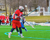 Baldwinsville Bees Charlie Bertrand (24) fires in a goal against the Cazenovia Lakers in Boys Lacrosse on Saturday, April 5, 2015 at Cazenovia, New York. Cazenovia won 13-5.