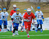 Baldwinsville Bees Eric Candee (10) bringing the ball up field against the Cazenovia Lakers in Boys Lacrosse on Saturday, April 5, 2015 at Cazenovia, New York. Cazenovia won 13-5.