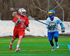 Baldwinsville Bees Sean Barron (11) with the ball being defended by Cazenovia Lakers #27 in Boys Lacrosse on Saturday, April 5, 2015 at Cazenovia, New York. Cazenovia won 13-5.