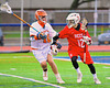 Baldwinsville Bees Connor Chapman (12) being defended by Liverpool Warriors player in Boys Lacrosse on Tuesday, April 29, 2014 at Liverpool, New York, Liverpool won 14-13 in overtime.