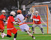 Liverpool Warriors Justin Renk (11) cutting in on Baldwinsville Bees goalie Daniel Thomas (15) in Boys Lacrosse on Tuesday, April 29, 2014 at Liverpool, New York, Liverpool won 14-13 in overtime.