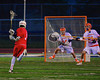 Baldwinsville Bees Mitch Rein (1) steps into a shot at the Liverpool Warriors goalie Kyle Halladay (24) in Boys Lacrosse on Tuesday, April 29, 2014 at Liverpool, New York, Liverpool won 14-13 in overtime.
