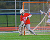 Baldwinsville Bees goalie Daniel Thomas (15) makes a save against the Liverpool Warriors in Boys Lacrosse on Tuesday, April 29, 2014 at Liverpool, New York, Liverpool won 14-13 in overtime.