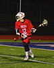 Baldwinsville Bees Connor Chapman (12) looking to make a play against the Liverpool Warriors in Boys Lacrosse on Tuesday, April 29, 2014 at Liverpool, New York, Liverpool won 14-13 in overtime.