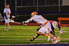 Liverpool Warriors Kendall Keahey (12) wins a face-off against Baldwinsville Bees Luke McCaffrey (20) in Boys Lacrosse on Tuesday, April 29, 2014 at Liverpool, New York, Liverpool won 14-13 in overtime.