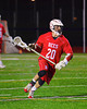 Baldwinsville Bees Luke McCaffrey (20) with the ball in overtime against the Liverpool Warriors in Boys Lacrosse on Tuesday, April 29, 2014 at Liverpool, New York, Liverpool won 14-13 in overtime.