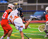 Liverpool Warriors Dominic Castglia (27) gets a shot off at the Baldwinsville Bees net in Boys Lacrosse on Tuesday, April 29, 2014 at Liverpool, New York, Liverpool won 14-13 in overtime.
